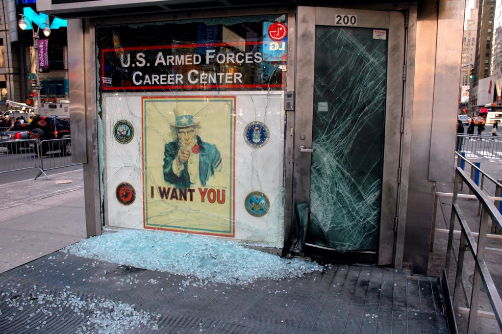 080306-M-0438D-002<br /> NEW YORK (March 6, 2008) An improvised explosive device blasted the entrance to the U.S. Armed Forces Career Center, a joint-service recruiting station located in Times Square at approximately 3:45 a.m. The blast caused no injuries; however, glass in the office's front door and window was shattered by the explosion, and the door's metal frame was bent. One of the busiest recruiting stations in the nation, the recruiting office is singularly located on a triangular island in the center of the iconic Manhattan intersection and has been the site of periodic anti-war protests. U.S. Marine Corps photo by Cpl. Karim Delgado (Released)